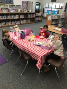 Teddy bear lovers enjoying a picnic in the Maidu library